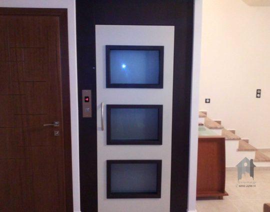 Πόρτα ανσανσέρ διχρωμία με χρώματα RAL